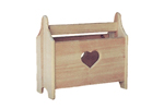 Heart magazine rack offers a place for keeping clutter at bay with charming country style
