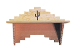 This shelf has a cactus desighn carved into the center for Southwestern style