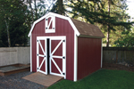 Yard barn with loft storage provides a couintry style charm that works great with a farmhouse style home plan