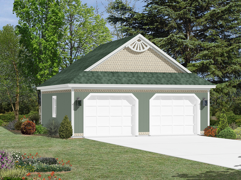 Two-car garage has intricate gable details that give it a Victorian style