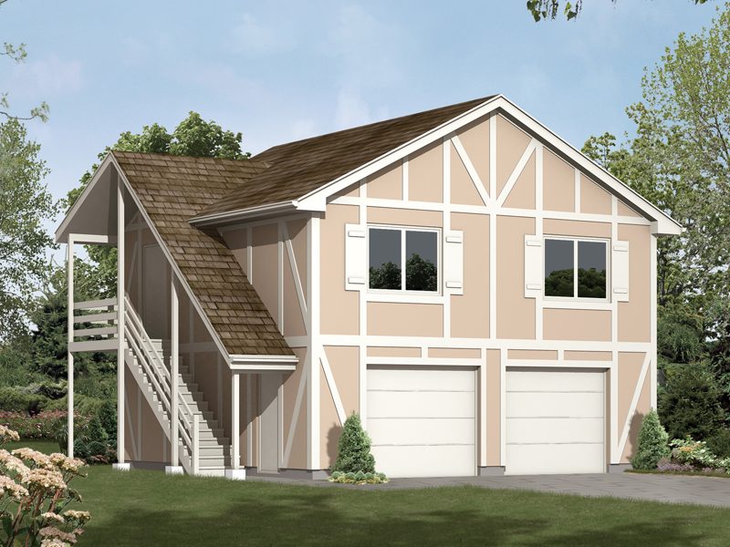 Two-story garage aprtment has side outdoor stairs and classic Tudor style trimwork