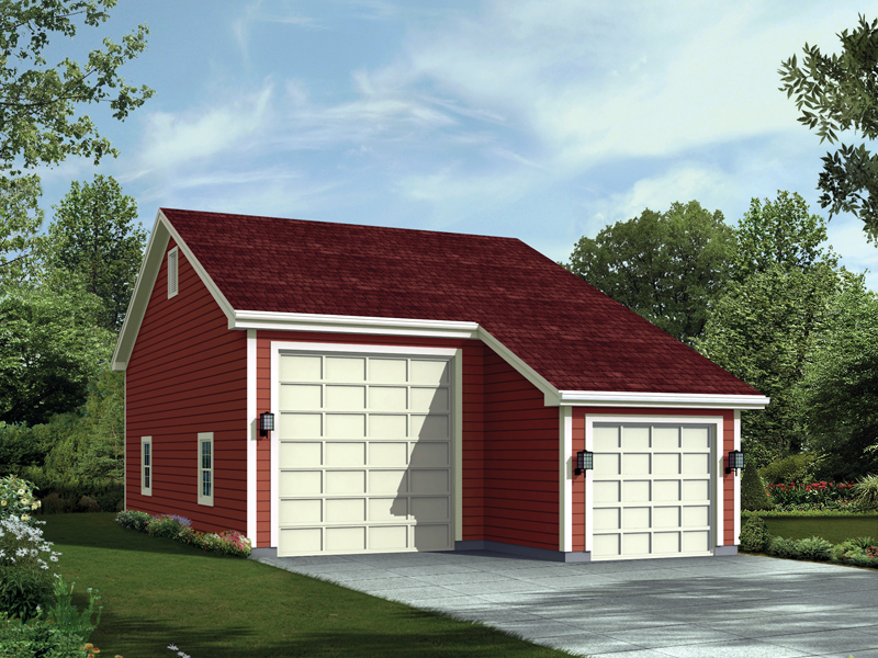 RV and regular sized garage has steep roof pitch and side windows for added sunlight