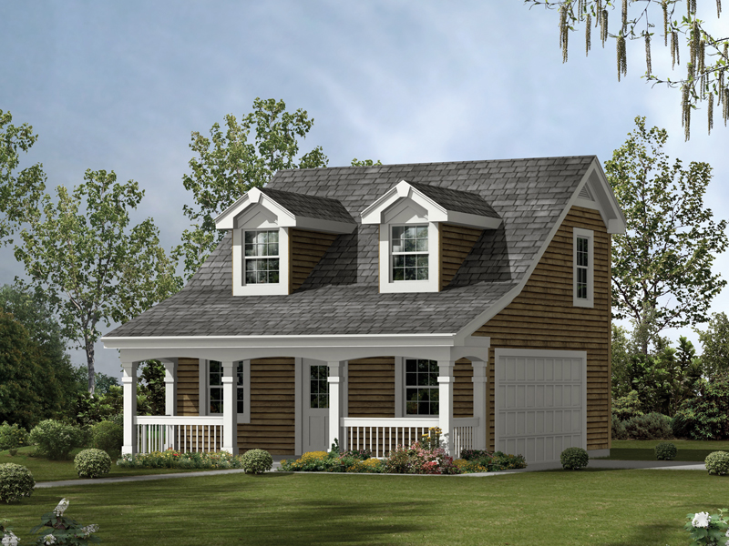 This two-car garage has the look of a cozy cabin with roof dormers and a covered front porch