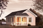Small cottage style structure with a covered porch is actually an RV garage with a rear entry
