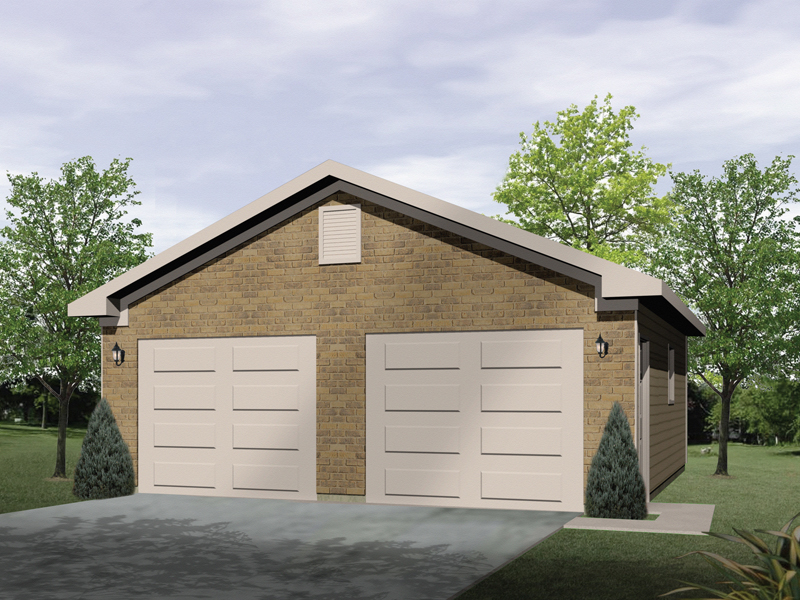 Gabled two-car garage has two separate garage doors and brick exterior