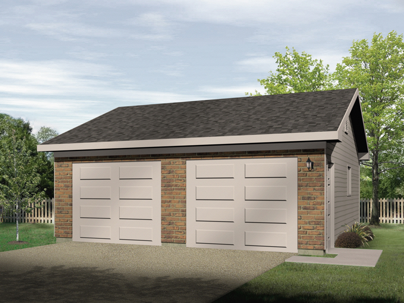 Two-car garage has two separate garage doors and brick exterior
