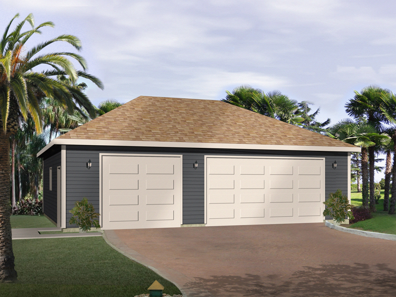 Three-car garage has elegant hip roof design