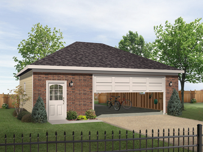 Two-car garage has hip roof design and entry door