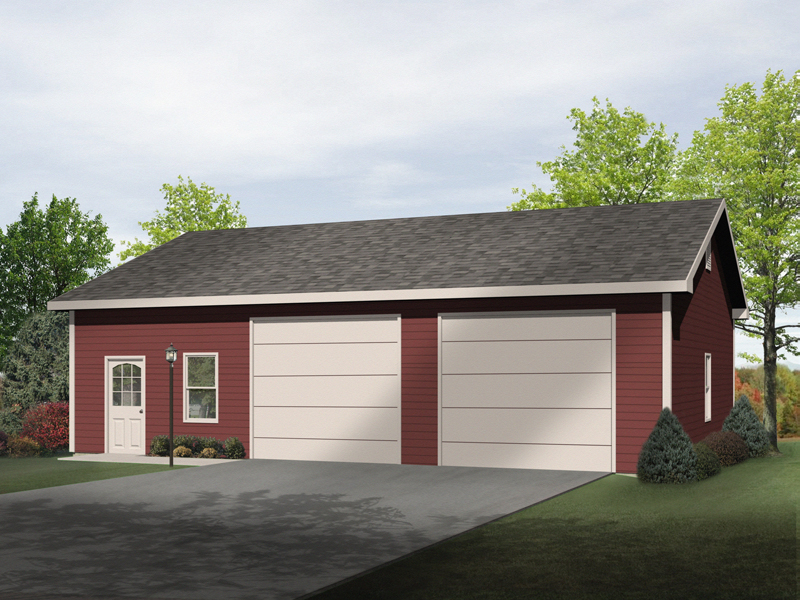 Two-car garage includes workshop space through door