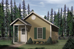 Traditional style cottage has covered front porch and steep roof pitch