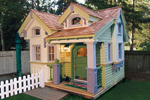 The Whipplewood cottage/playhouse has tremendous style with a cedar shake roof and cottage style charm