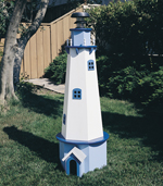Painted wood lighthouse is a great backyard decoration