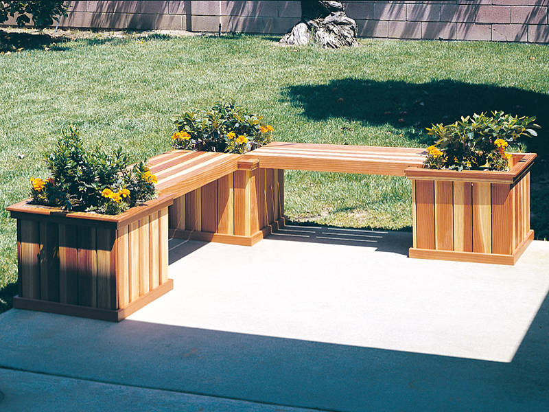 lshaped planter bench has three square planters and two sections of bench space for