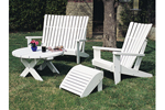 Adirondack quartet includes a round table, ottoman and two chairs all shown painted white for a fresh summer look
