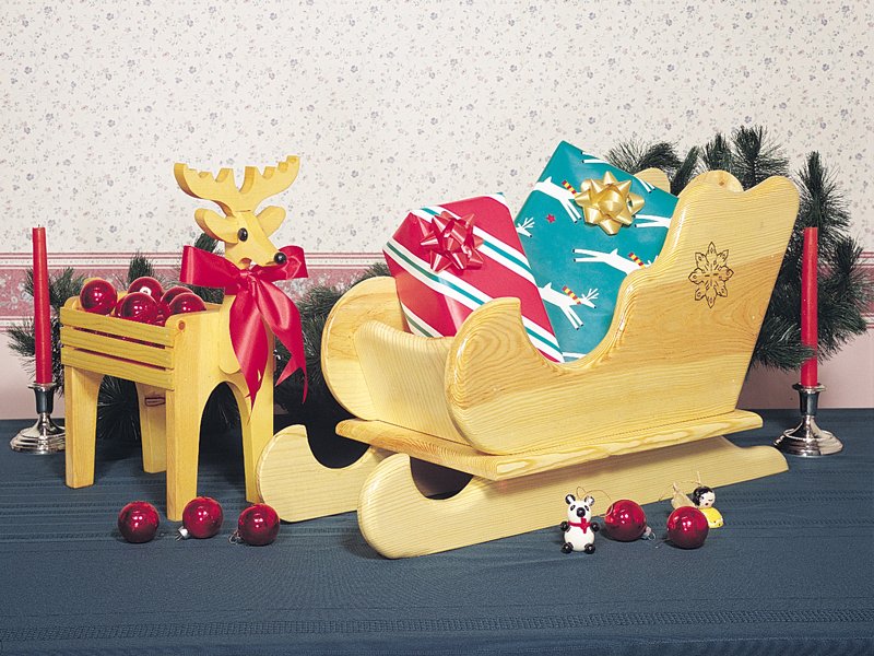 This table-top sleigh is the perfect size for holding gifts or creating a fun, Christmas scene