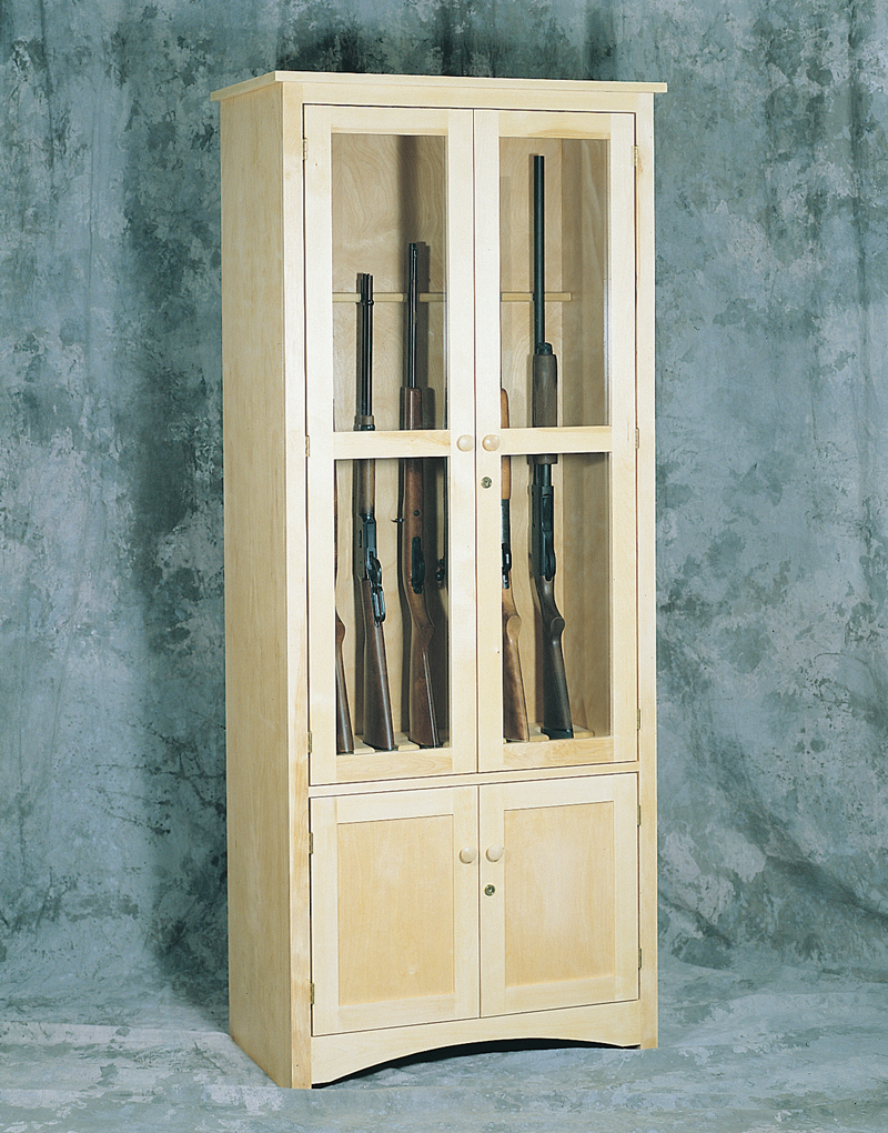 This sturdy gun cabinet keeps guns behind a door that could easily be locked for safety