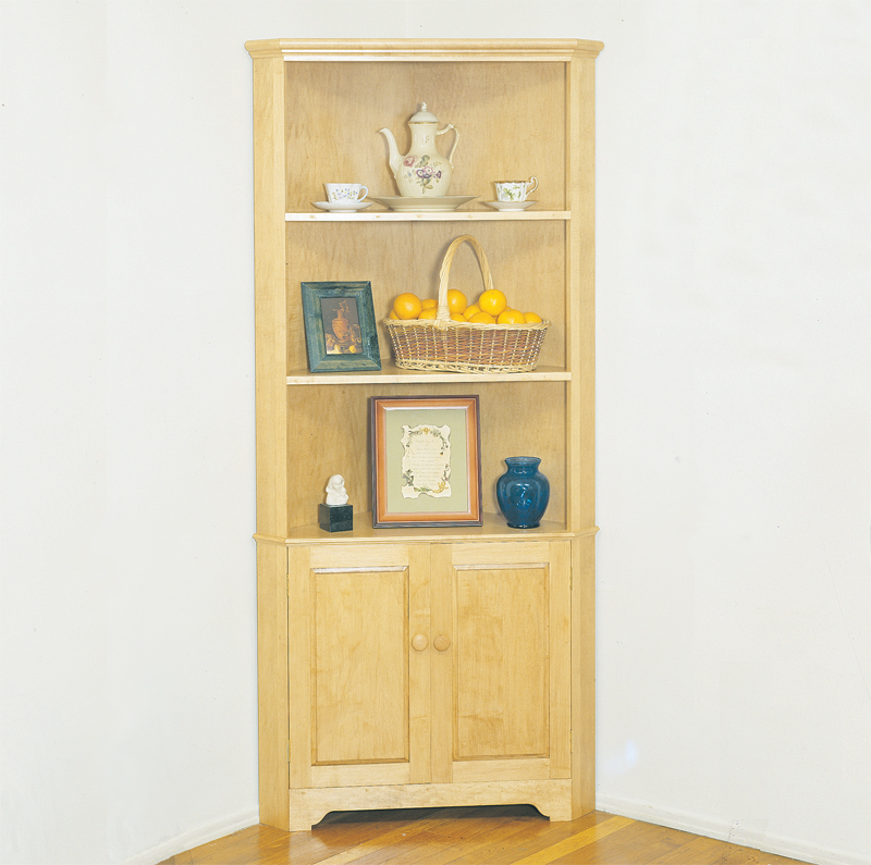 A handy corner cabinet provides an ideal spot for displaying collectibles without taking up much space