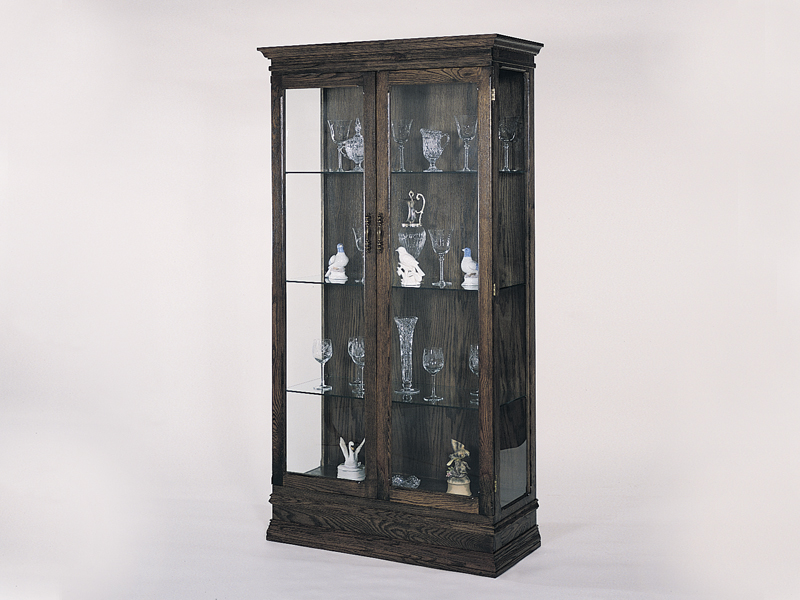 Dark wood create a curio cabinet that is elegant and rich in design