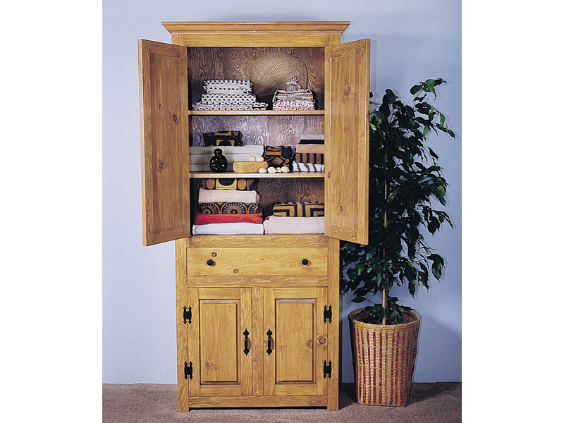 This all wood linene closet provides plent yof extra storage space if the home's linen closets are too small