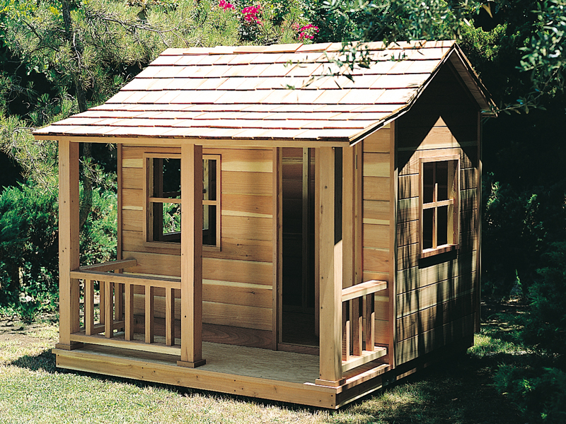Rustic children's playhouse with side windows and covered front porch