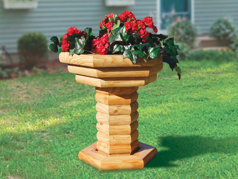 Landscape timber plant stand is a sturdy planter perfect for the front or backyard