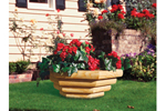 Landscape timber bowl planter makes a strong statement and has plenty of space for flowers