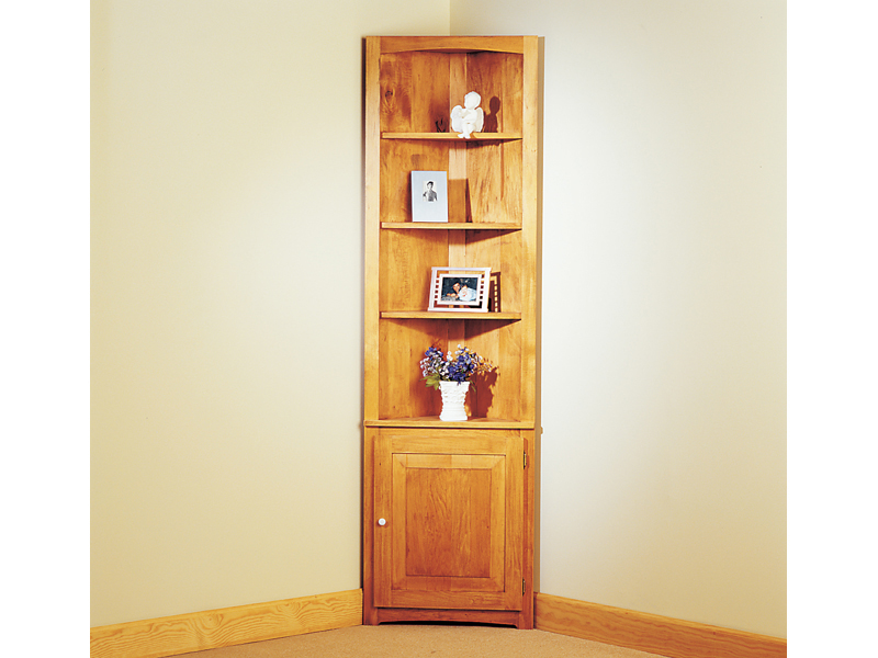 Space efficient cozy corner cupboard offers a great place to display collectibles