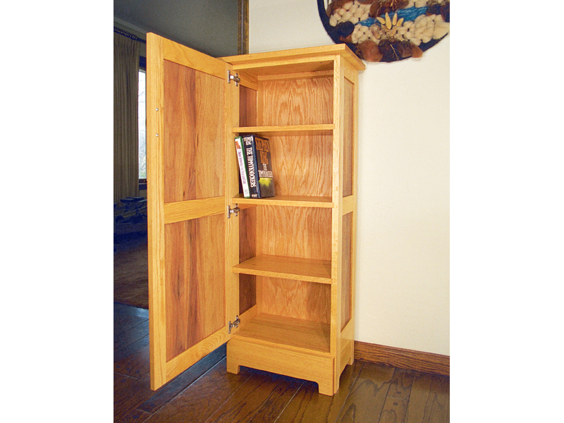 All wood jelly cupboard has a door that closes across the front