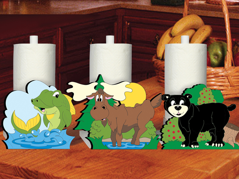 Woodland paper towel holders are decorated with a fish, moose and black bear