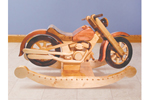 This rustic motorcycle rocker is sure to get the kids in the family excited
