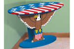 This patriotic table has a bald eagle design as the stand with a stars and stripes pattern on the top