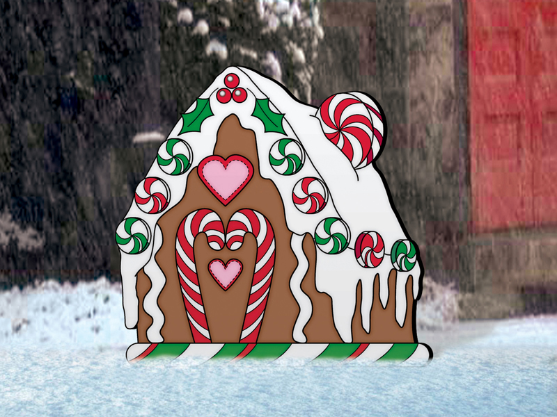 Cute gingerbread house design looks great with the gingerbread man and woman