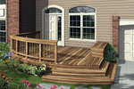 Low-level deck has a portion with a railing and shallow steps to the ground level