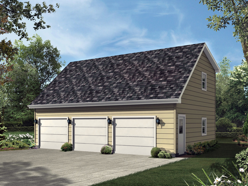 Three-car garage has the look of a one-story when actually it has a vaulted loft on the second floor