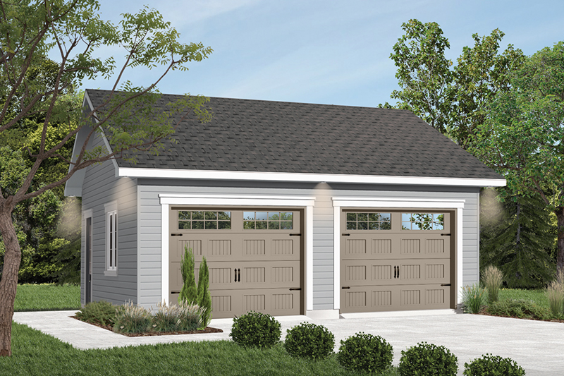 Spacious two-car garage has charming country style garage doors
