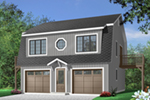 Two-story style two-car garage apartment has symmetrical feel with round center window